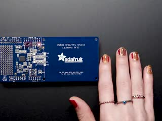 Hand swipes close to RFID reader, and manicure lights up