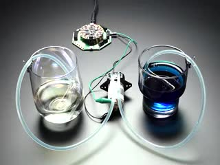 Peristaltic Liquid Pump moving blue liquid from a blue cup to a clear cup