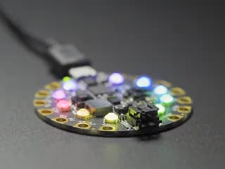Circuit Playground with crystals on 10 LEDs, glowing rainbow