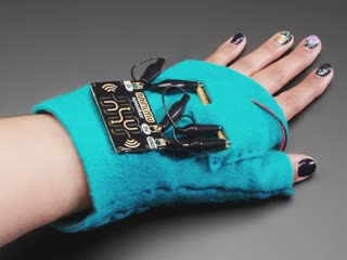 Animation of hand with glove moving, and musical notes coming out of speaker