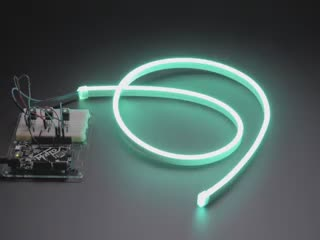 Coiled LED neon tubing changing through rainbow colors