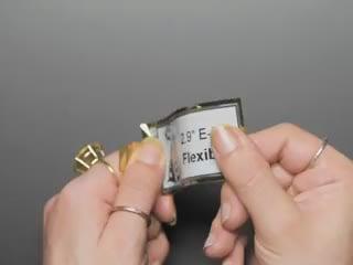Hands flexing an E-Ink display