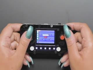 Person playing Digi-Key game on PyGamer