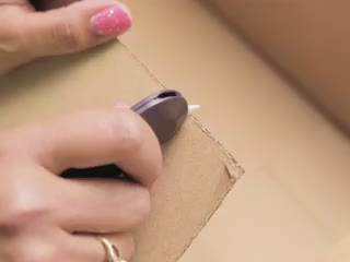 Person quickly cutting cardboard in half