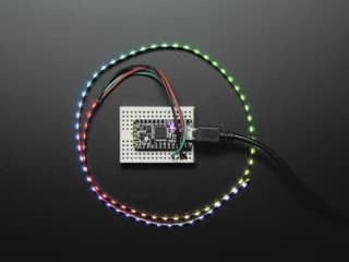 Curved NeoPixel LED strip wired to arduino, with each LED changing to a different color in the rainbow