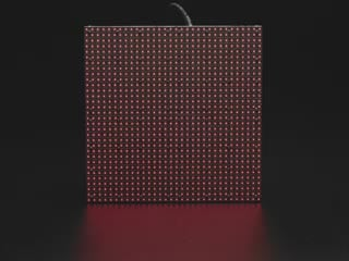 """Video of powered on 64x64 RGB LED matrix displaying brightly colored animations with the text, """"Drawing Pixels"""""""