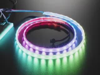 Video of powered-on NeoPixel strip 1 meter long running rainbow LED example code.