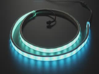 Video of loosely coiled LED strip flashing rainbow colors.