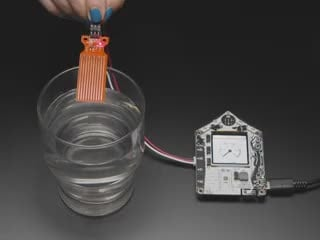 Video of someone dunking the water sensor into a glass of water. The TFT on the FunHouse displays a wetness gauge that goes from 0 to 100.