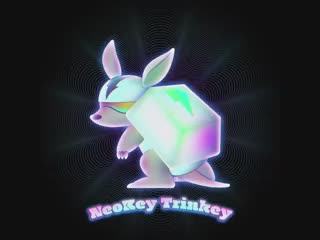 A video of the NeoKey Trinkey creature that is like an armadillo with a keycap on its back which emits rainbow colors.