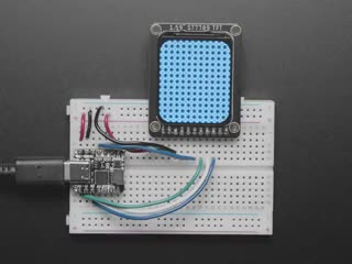 """Video of 1.69"""" 280x240 Round Rectangle Color IPS TFT Display plugged into a breadboard and QT Py. The TFT displays various geometric art."""