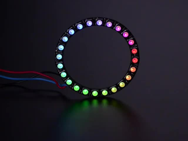 NeoPixel Ring with 24 x 5050 RGBW LEDs lighting up rainbow and white