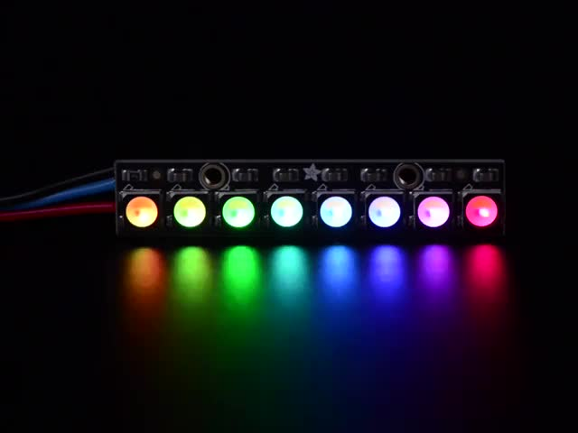 NeoPixel Stick with 8 x 5050 RGBW LED lit up rainbow and white