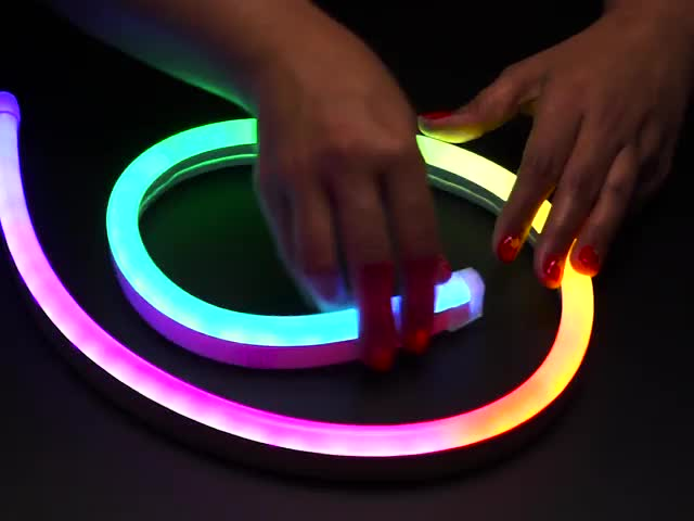Hand flexing NeoPixel RGB Neon-like LED Flex Strip with Silicone Tube