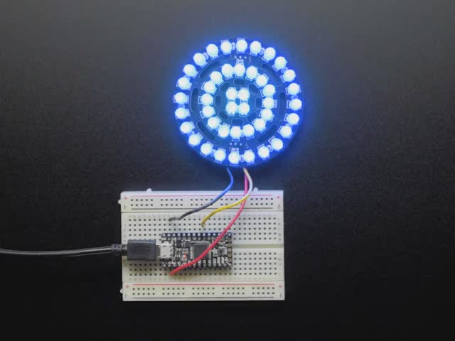 NeoPixel Triple-Ring Board with 44 Thru-Hole LEDs wired to Arduino, lighting up rainbow